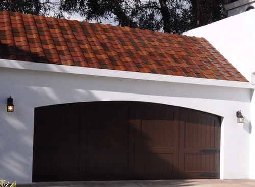 Tesla unveils solar roof tile plans durability design news for Tuscan roof design