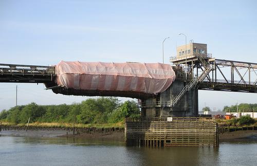 Bridge with containment