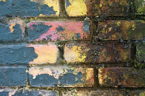 Coated brick wall