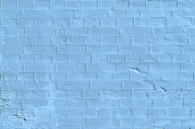 Coated brick wall