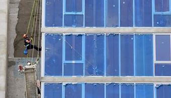 Worker Dangles From Scaffold at FL Site